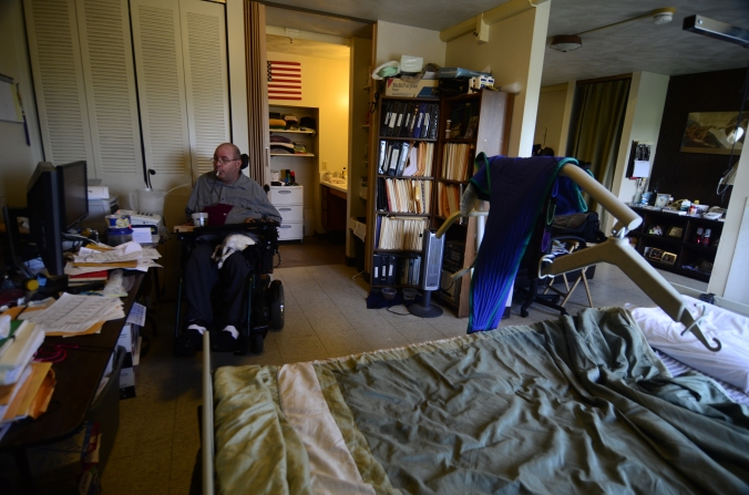 Attorney Max Lewis works on his computer at home on Tuesday, July 14, 2015. Max lives below the federal poverty level to receive assistance for his disability, caused by a diving accident in 1986. AMBERLE GARRETT/Missourian.