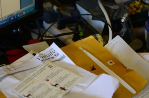Stamps and papers cover Max Lewis' desk on Tuesday, July 14, 2015. Lewis works as a pro bono attorney in divorce and custody cases. AMBERLE GARRETT/Missourian.